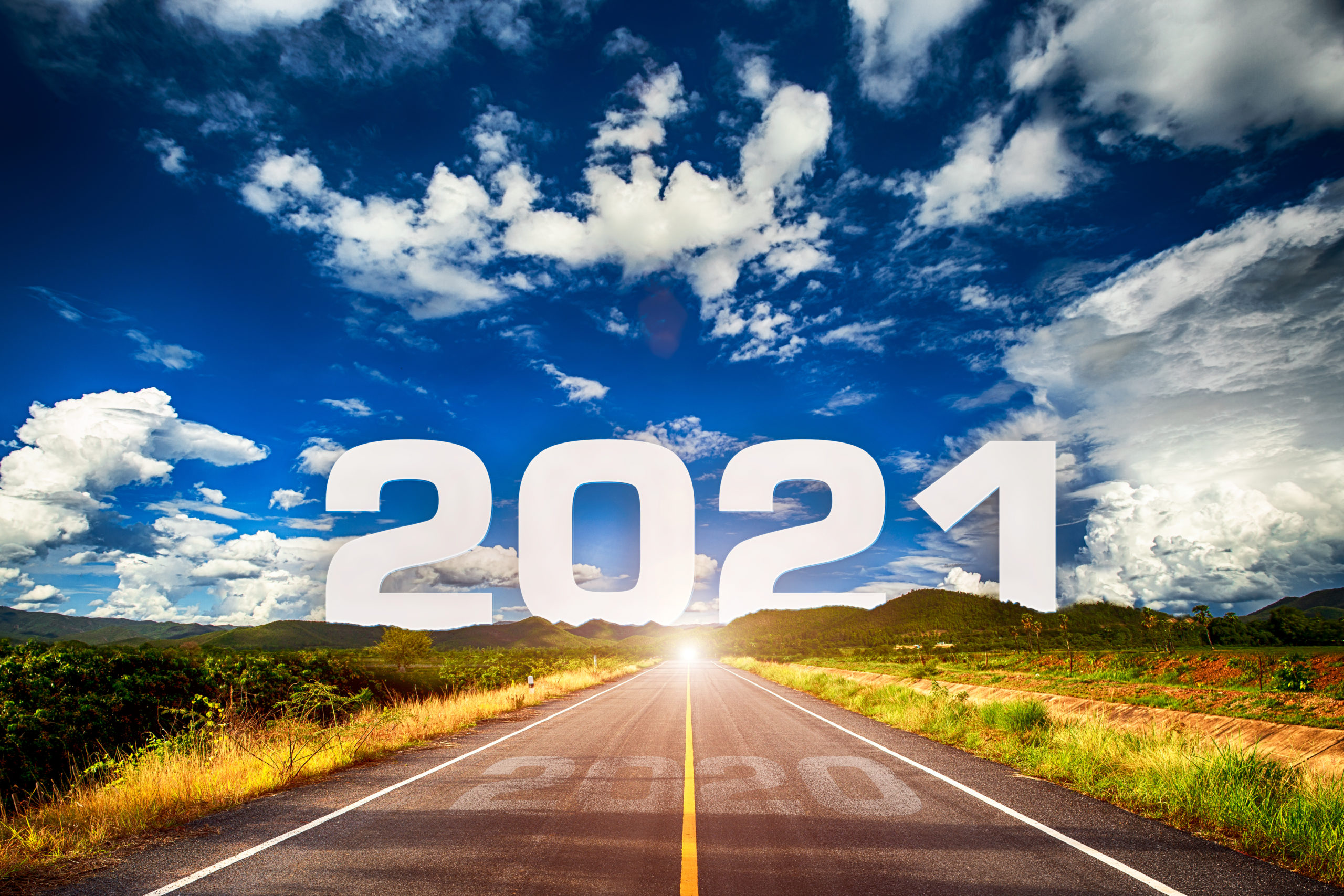 The Word 2021 Behind The Mountain Of Empty Asphalt Road At Golden Sunset And Beautiful Blue Sky. Concept For Vision Year 2021. By Atk Work Scaled